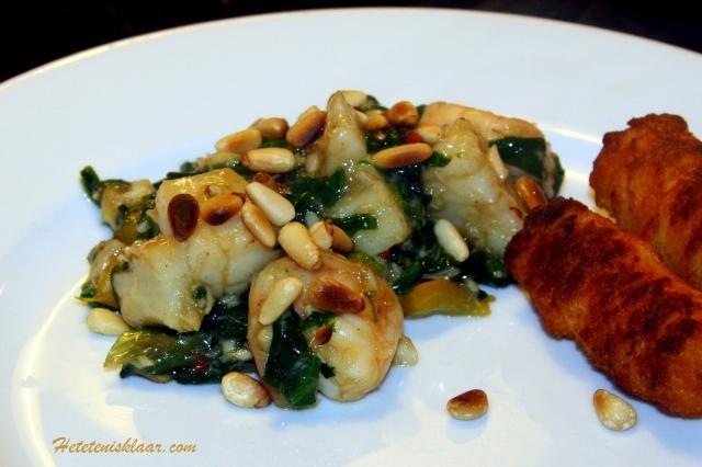 Coquilles en garnalen uit de wok